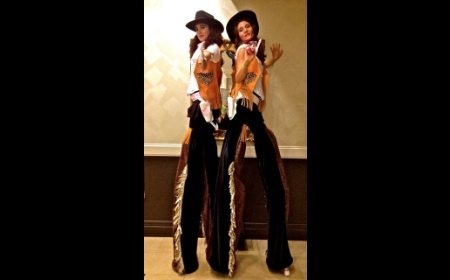 Cowgirls on stilts