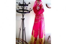 Pink Genie on Stilts