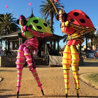Lady Bugs Stilt Walkers