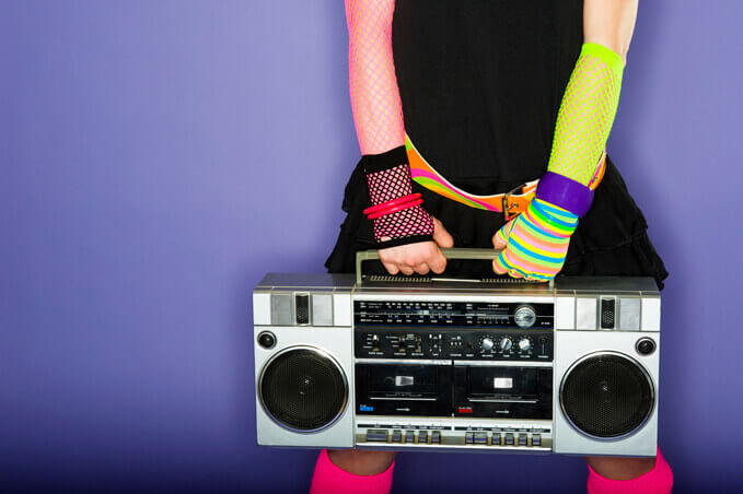 A 1980's styled woman holding a boom box