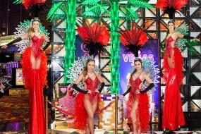 Red Showgirls Stilt Walkers