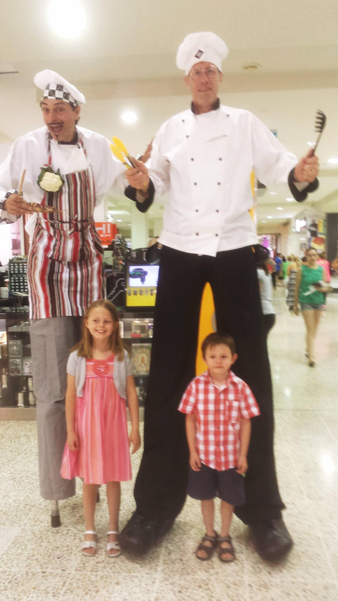 Italian waiters / chefs on stilts