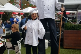 Italian waiters / chefs on stilts
