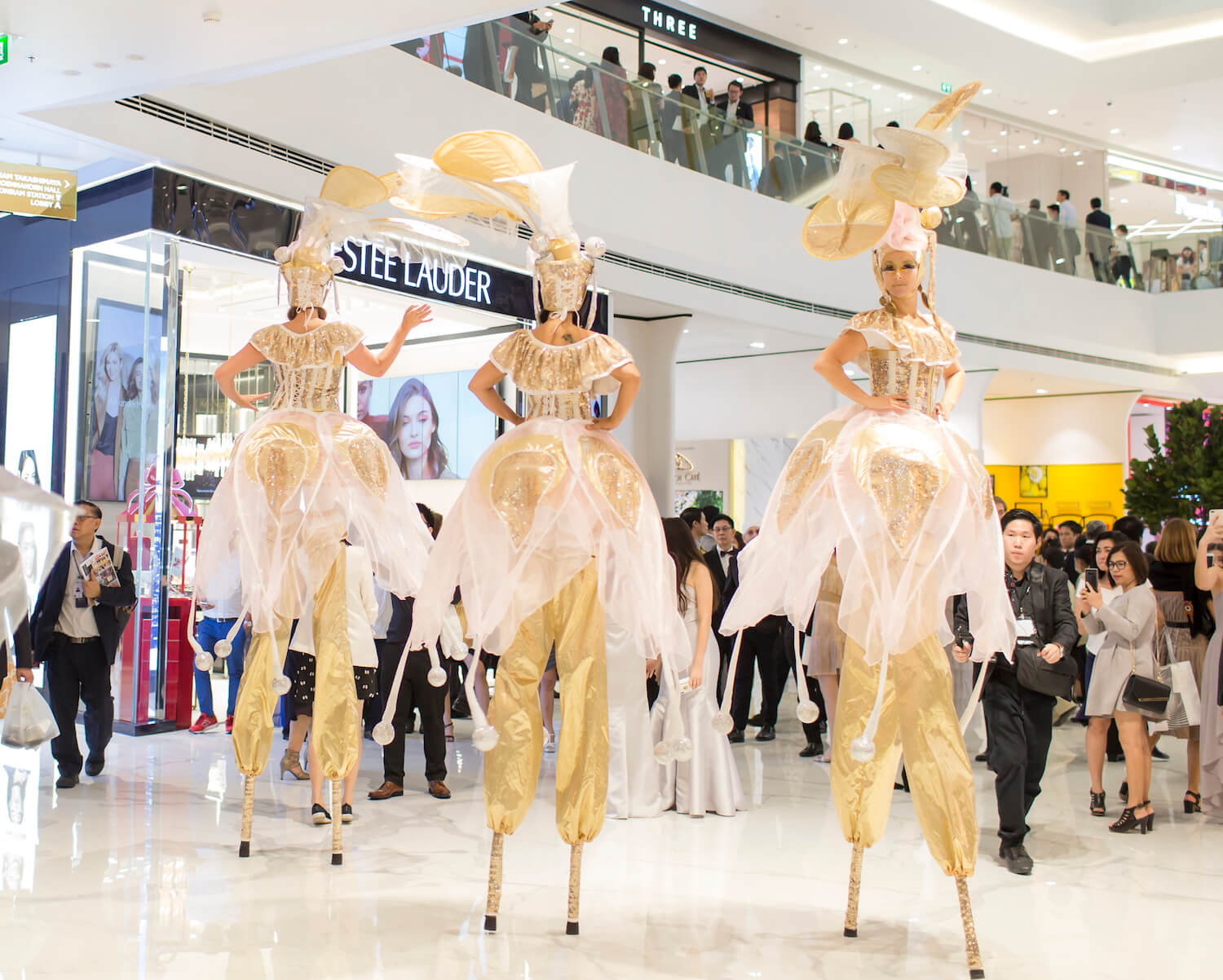 Golden Blossoms Stilt Walkers